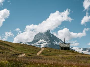Hiking trail to the Riffelberg chapel with the Matterhorn in the background