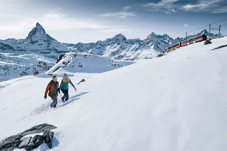 Couple winter hiking at the Gornergrat above Zermatt