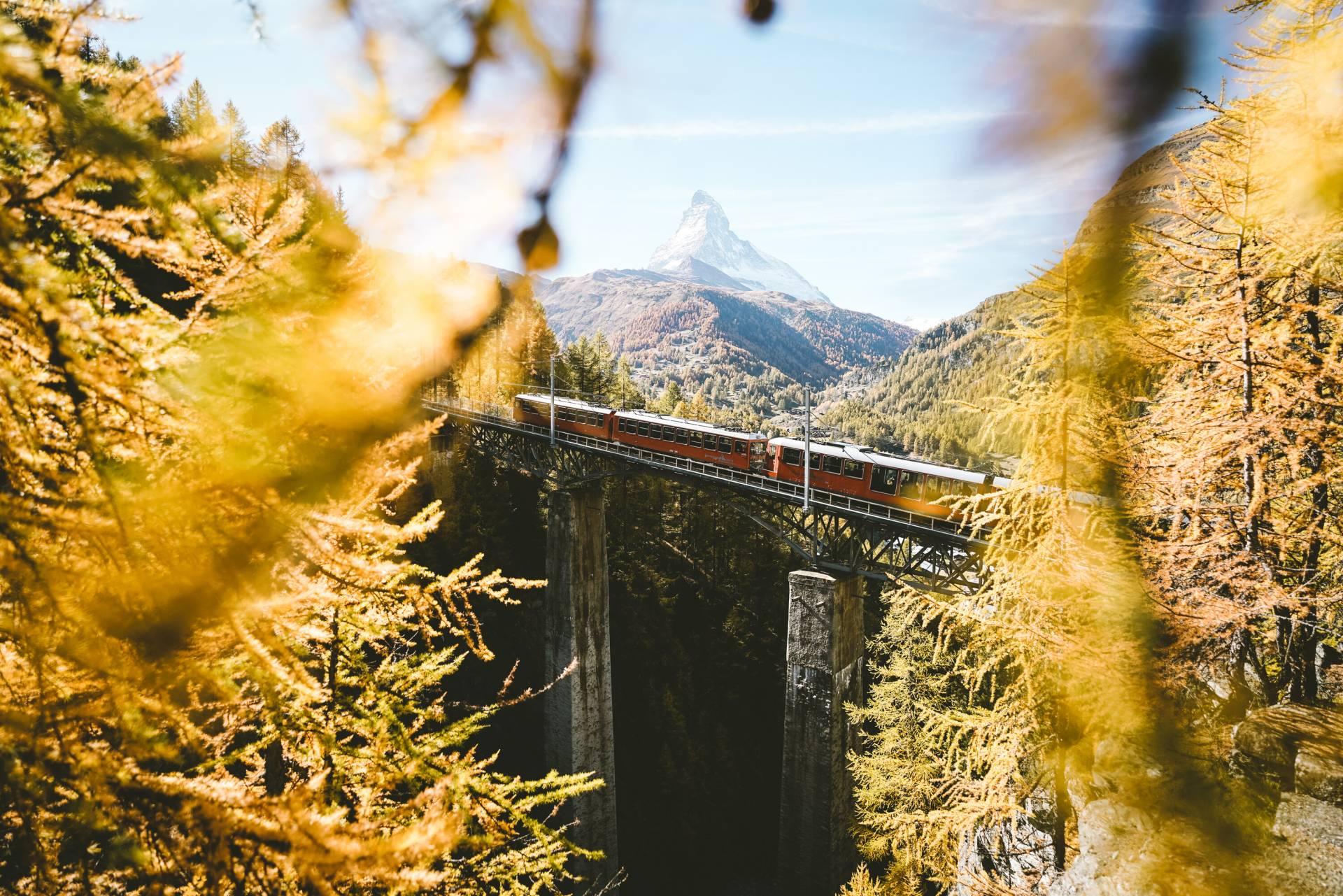 Gornergrat railway on the Findelbach bridge above Zermatt in autumn
