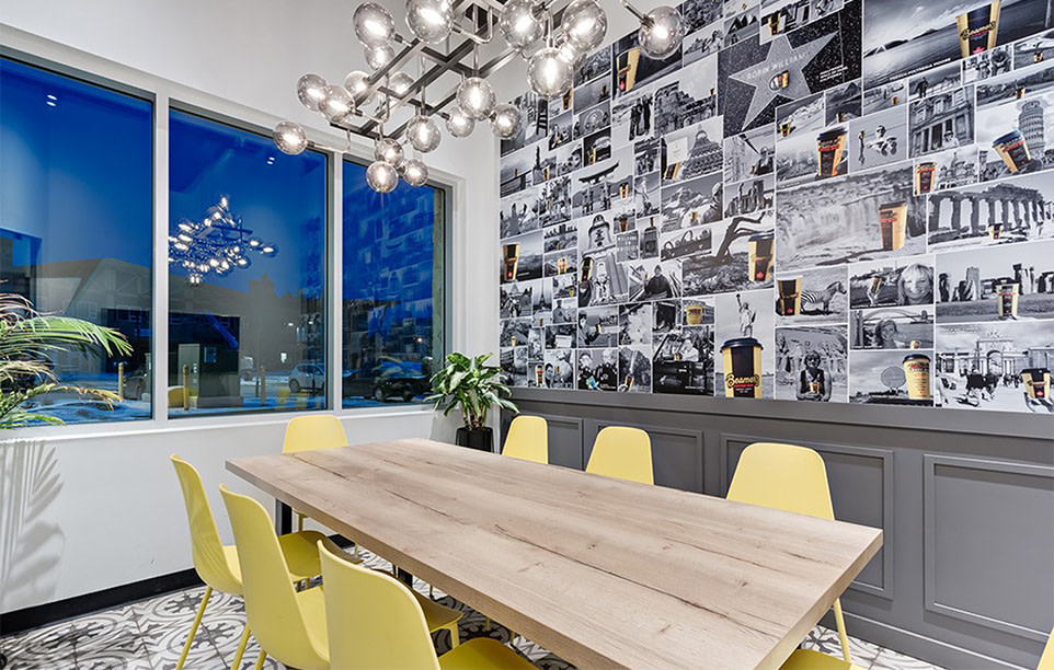 Meeting room with pictures of Beamer's coffee cups on the wall