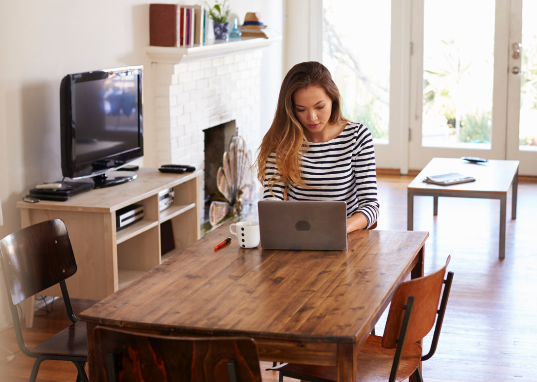 Person working from home at their kitchen table