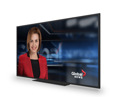 A tv showing a news broadcast