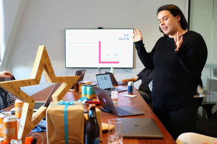 Liz from our marketing team presenting her project during our first Dovetail hackathon.