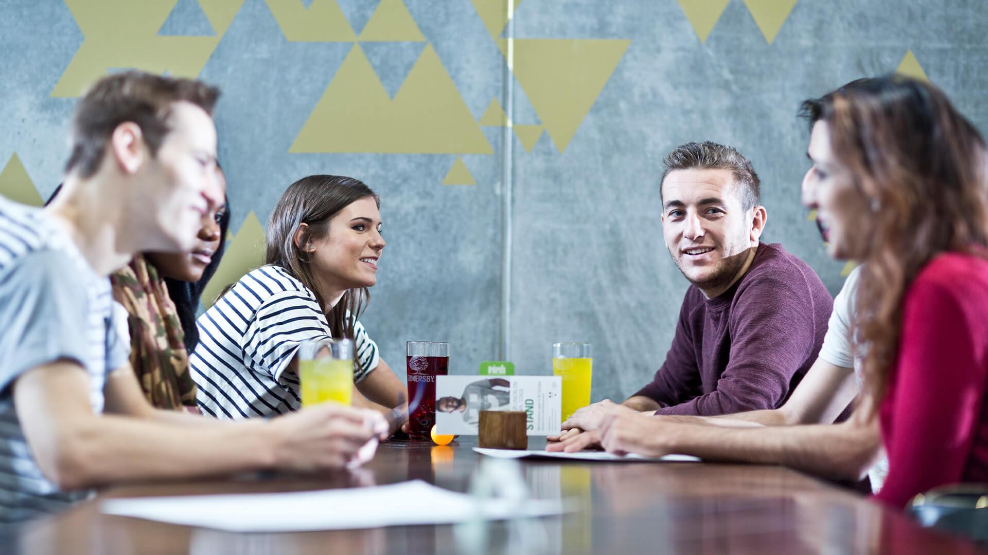 Students socialising in the Art School Café on the Manchester Metropolitan University campus
