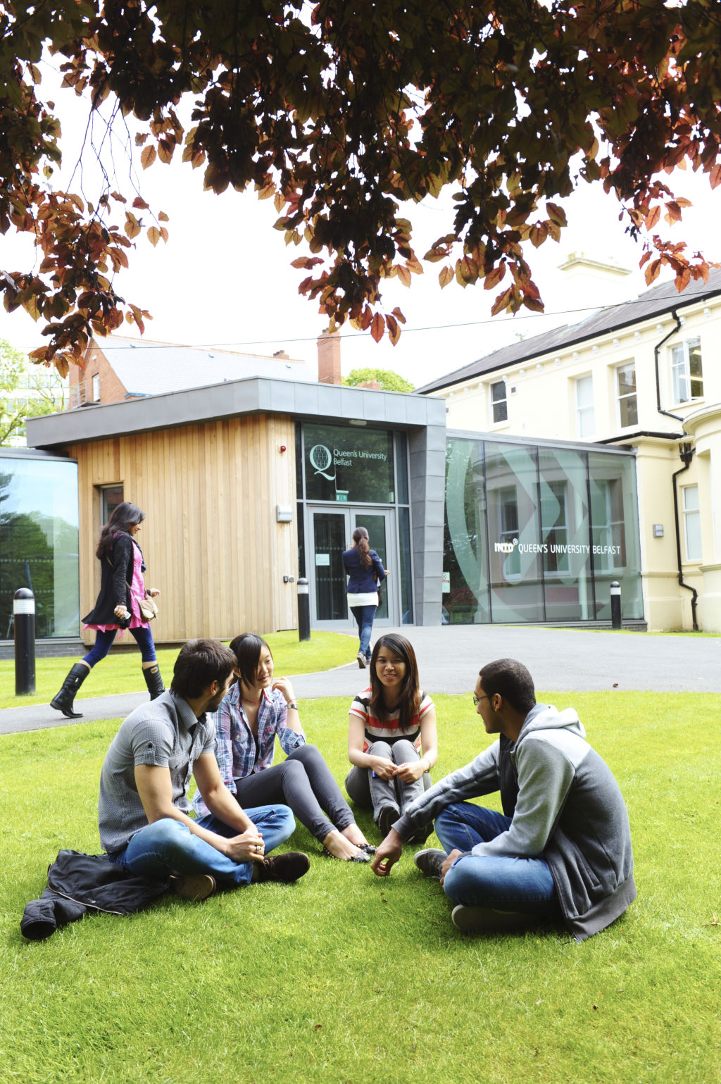 Students sitting outside the INTO Centre