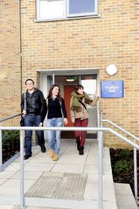 Student outside an entrance to Park Challinor student residences