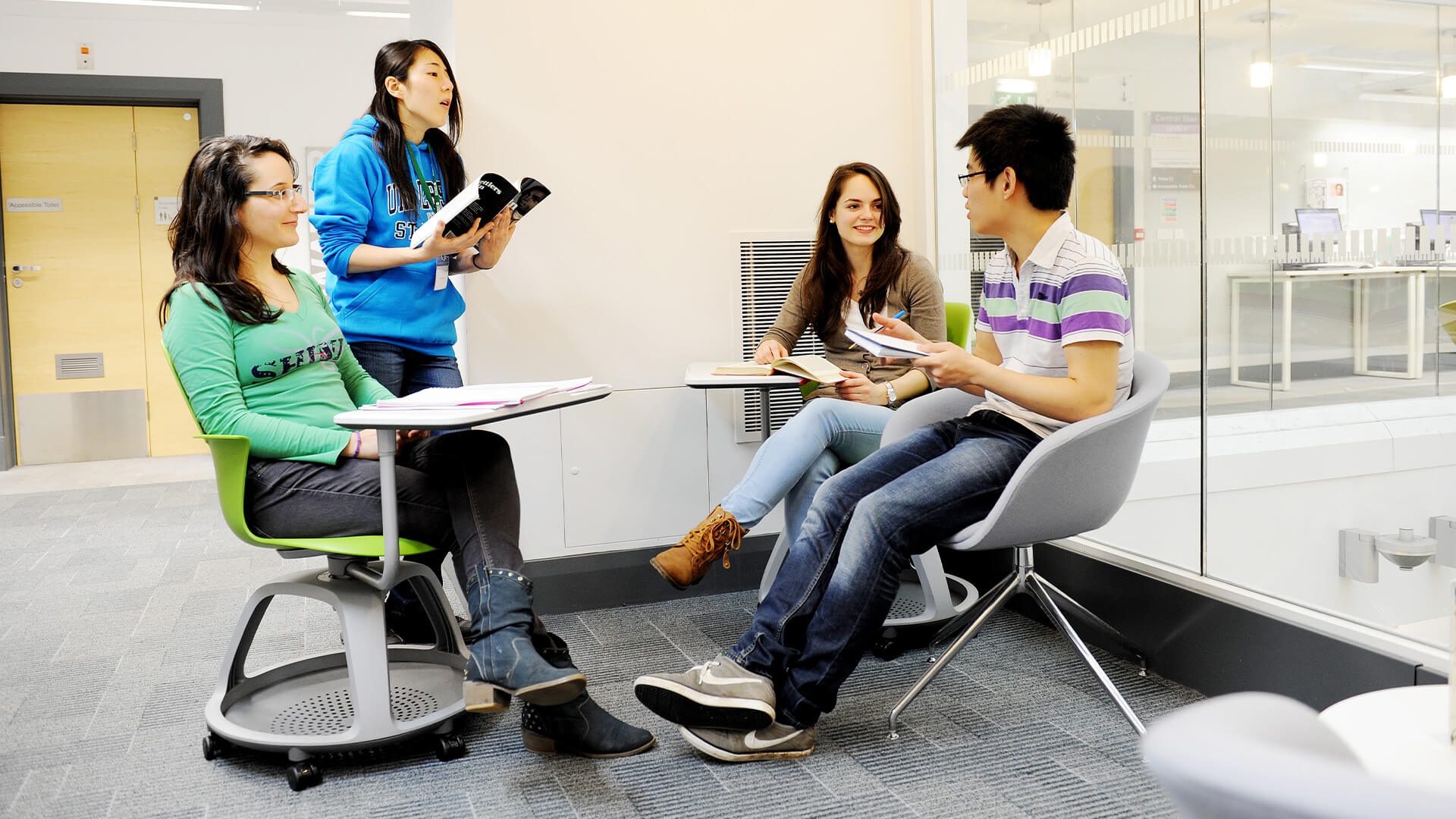 Students studying in the University of Stirling campus library