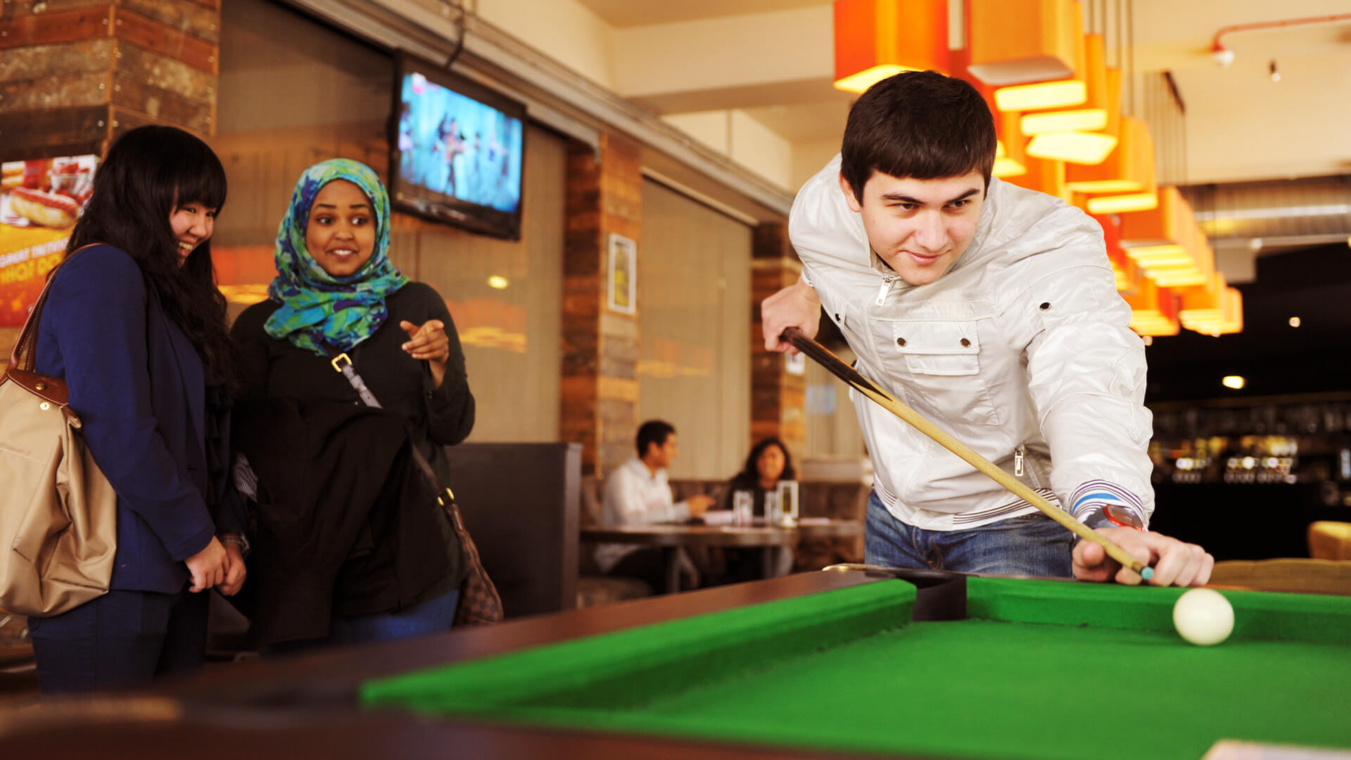 Students playing pool at the students' union at the University of Manchester