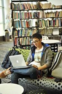 International student working in Learning Resource Centre with laptop