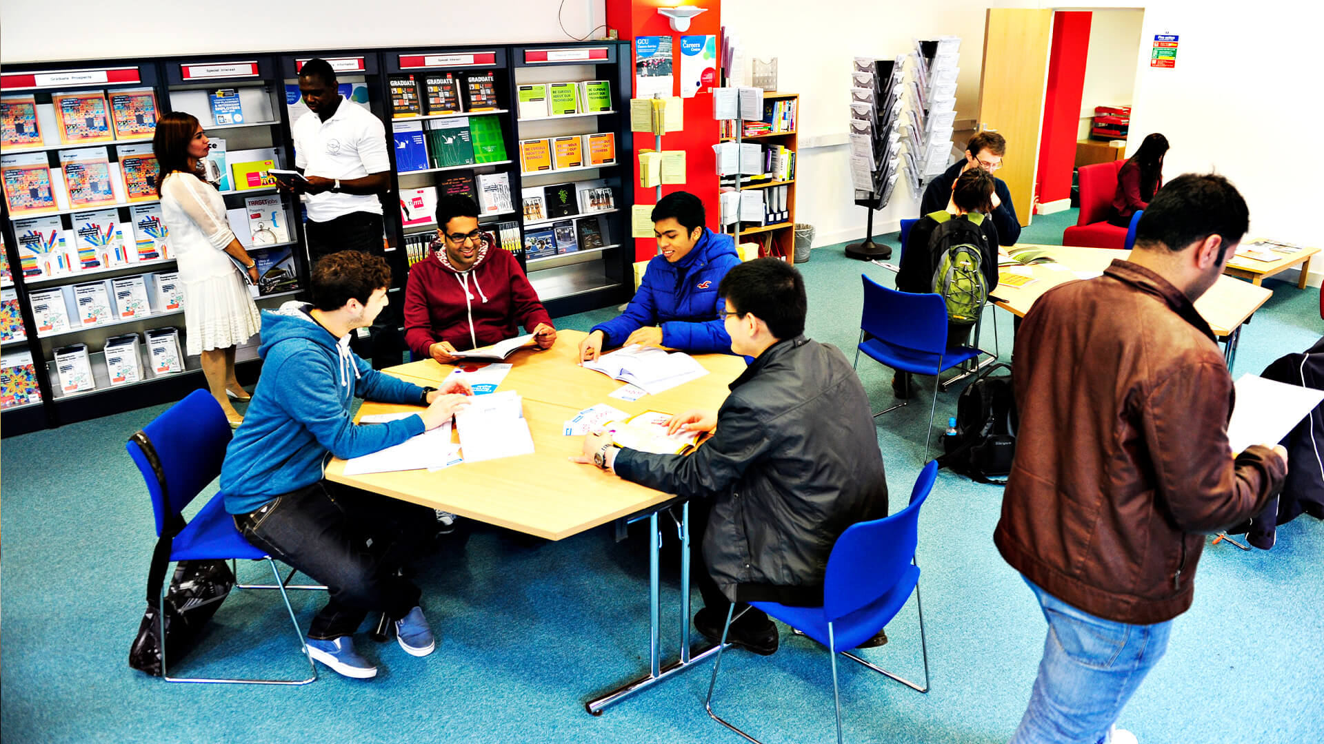 Students studying in one the the many breakout areas on the Glasgow Caledonian University campus