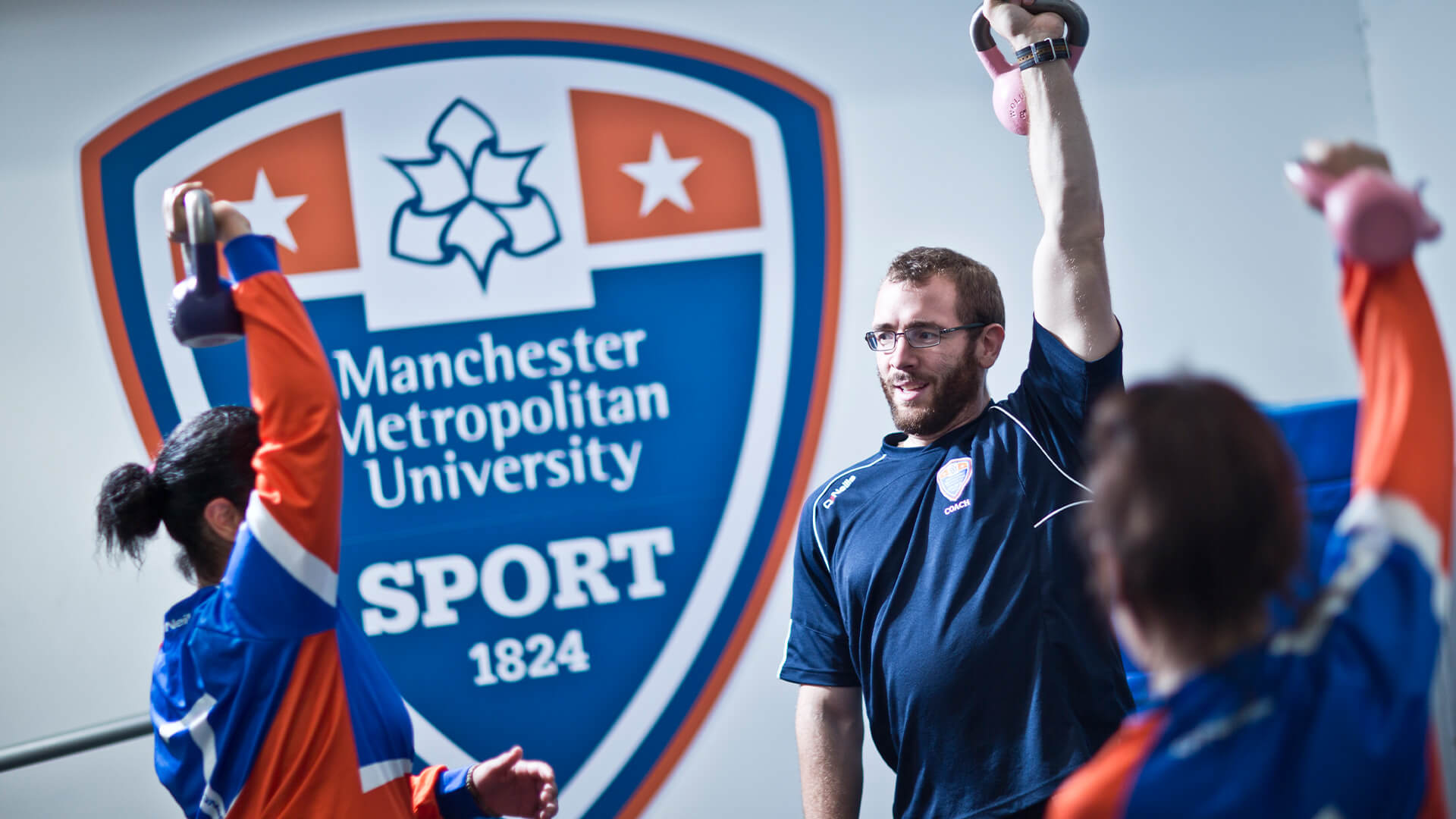 Students taking part in a free drop in sports session at Manchester Metropolitan University