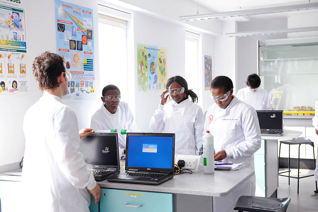 Students working in an INTO Centre science lab