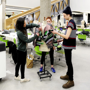 A group of INTO students design and create a dress on mannequin