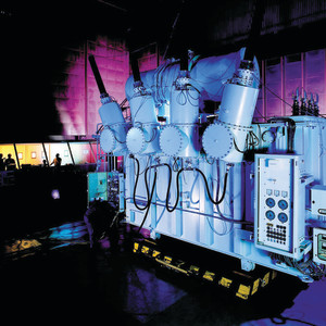 A large power unit in a purple backlit room