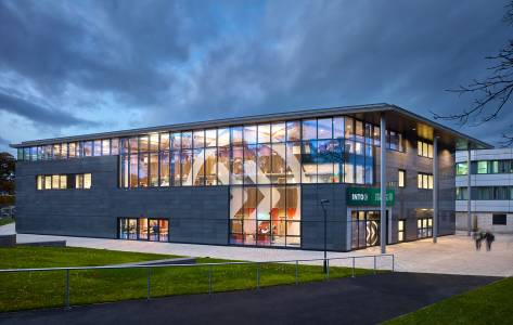 Exterior view in the evening of the INTO Centre at University of Stirling