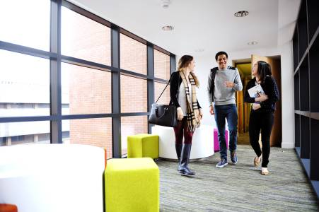 Students walking through INTO student residences building