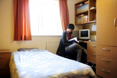 Student studying in Park Challinor bedroom