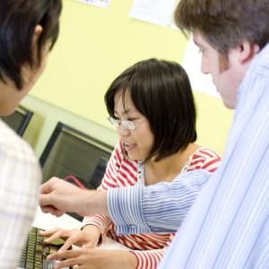 A student watches as a teacher explains a graph