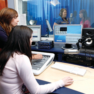 INTO Students working in a sound studio