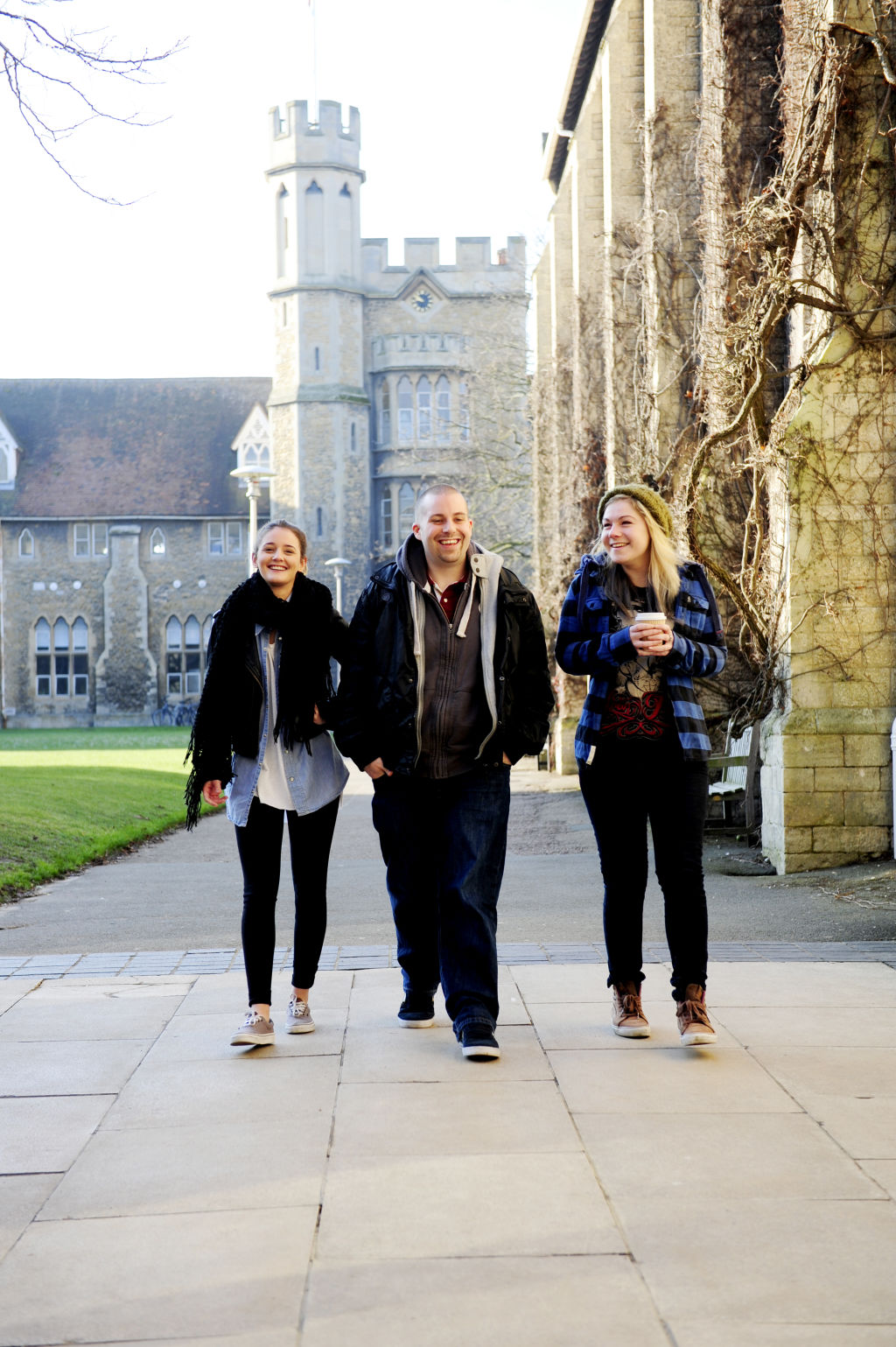 Students walking through University of Gloucestershire campus