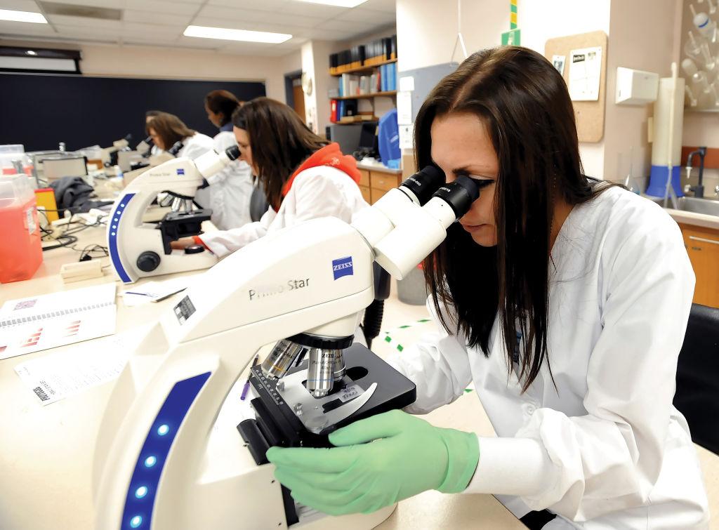 Marshall female student microscope