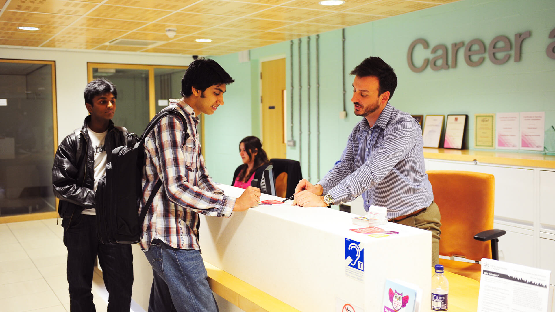 International student talking to a memeber of staff at the Student Hub Careers Service at City, University of London
