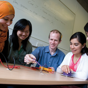 INTO students and teacher with wires