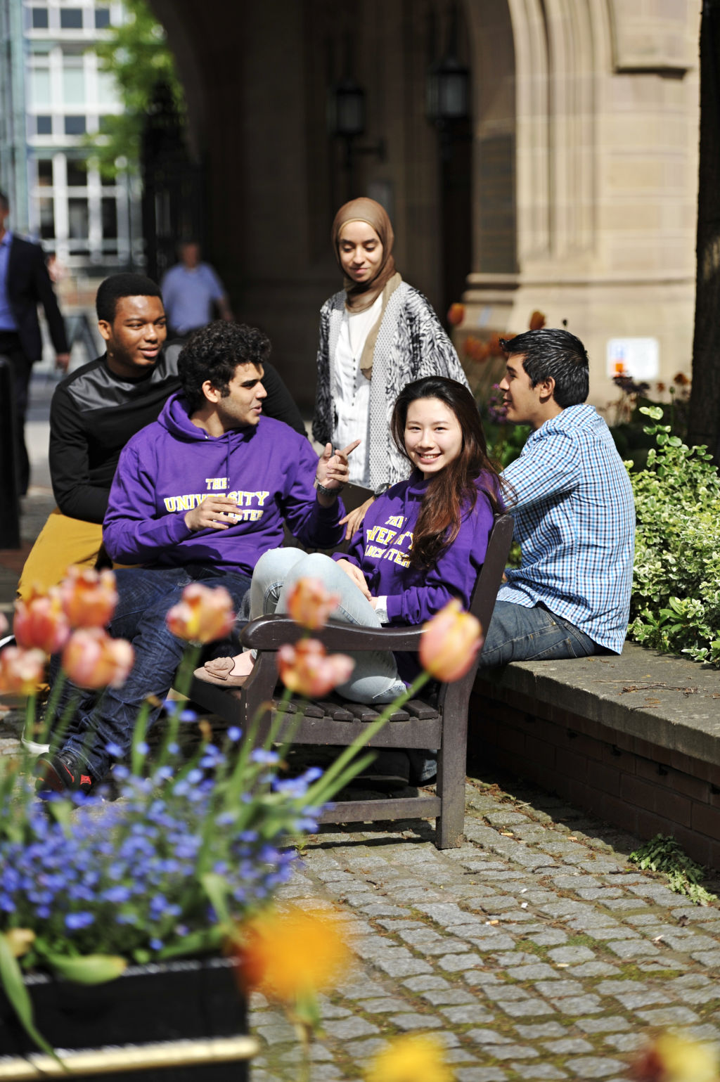 Students outside The University of Manchester