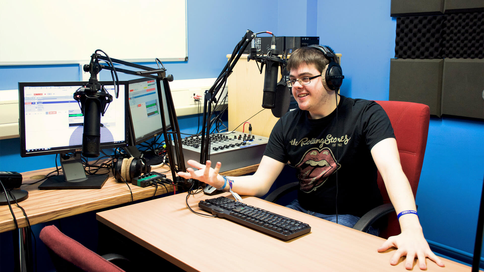 Student recording a radio show for Radio Caley at Glasgow Caledonian University Students' Association