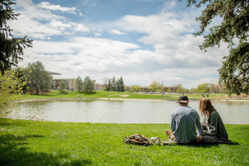 CSU Students sitting by the lake