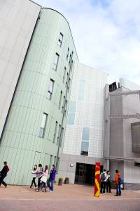 View of main entrance of the INTO Centre with international students outside