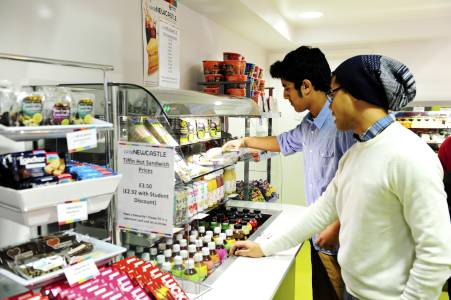 International students in INTO centre Cafe choosing food
