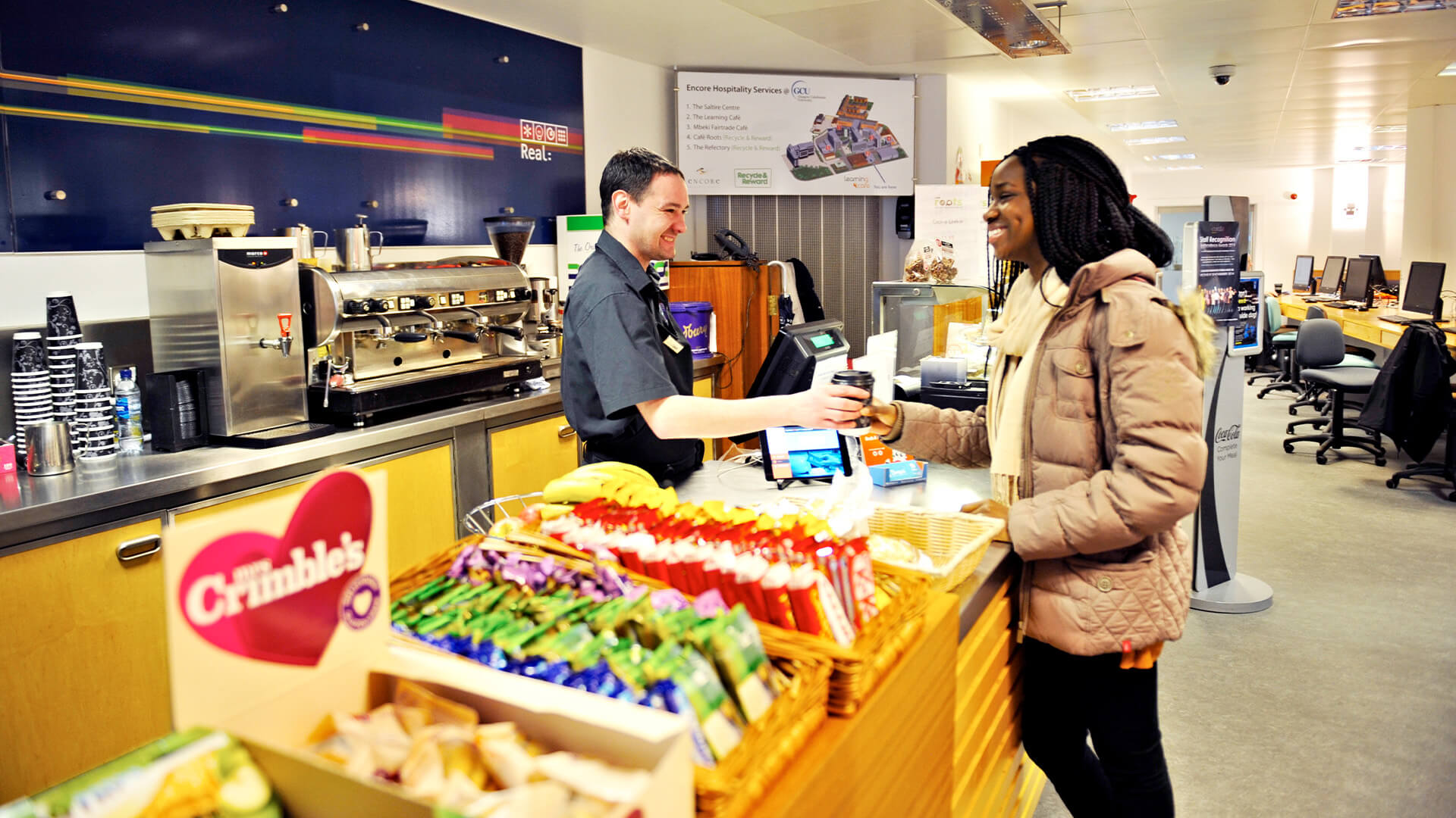 International student buying food at Learning Café on Glasgow Caledonian University campus