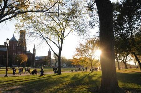 Students walk during sunset at George Mason University