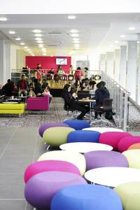 International students in lobby area in INTO centre