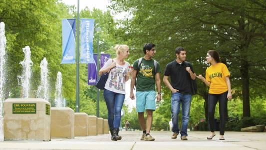 International students walk on campus at George Mason University