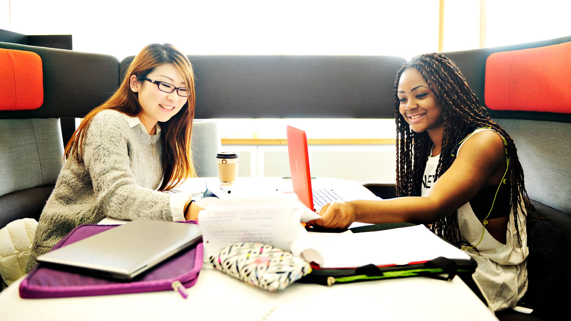 Students studying in a breakout area on-campus at the University of Manchester