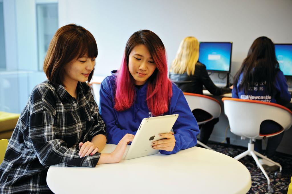 Newcastle University London students using an iPad