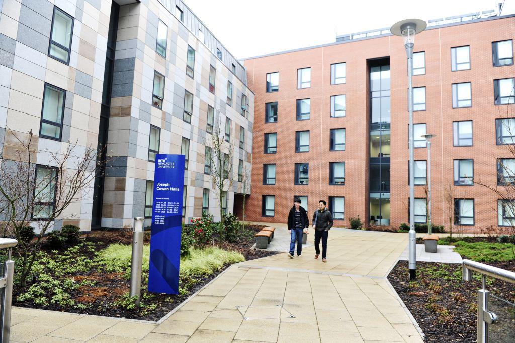 Students walking outside INTO Newcastle University Joseph Cowen Halls