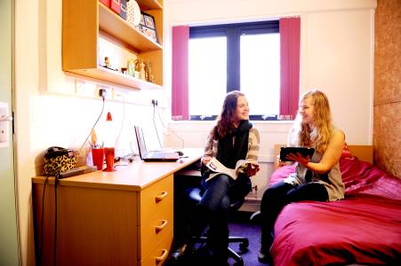 Students talking in a student bedroom at INTO Stirling John Forty's Court