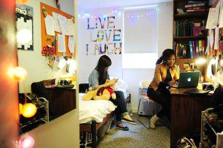 Students socialising in an INTO University of East Anglia en suite room