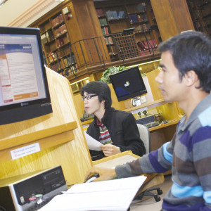 Students working on computer in Newcastle University Old Library Building