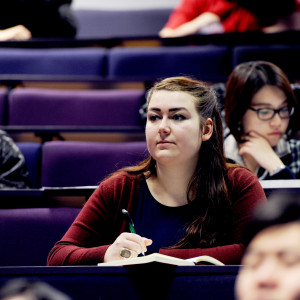 INTO International student listens to a lecture