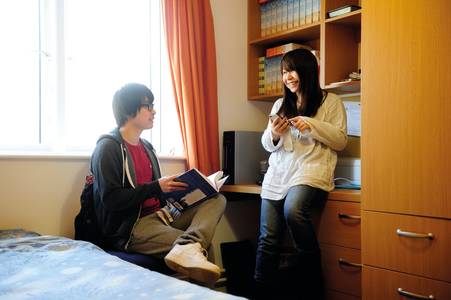 Students talking in a student bedroom in Park Challinor residences