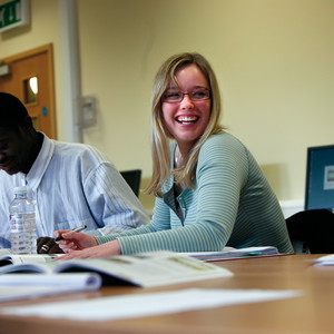 International student laughs during class at University of Exeter
