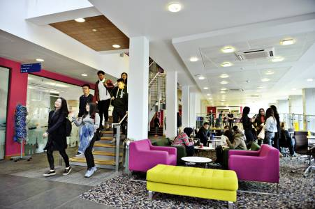 International students in breakout area in INTO centre