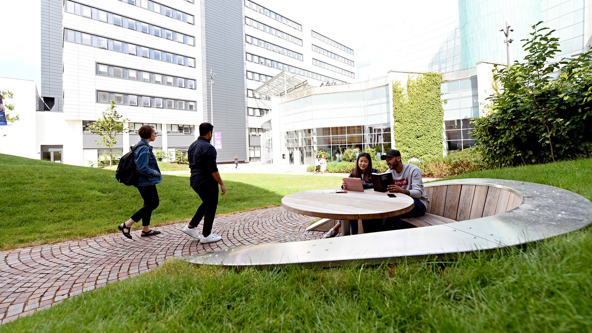Students enjoying outdoor space at Glasgow Caledonian University campus