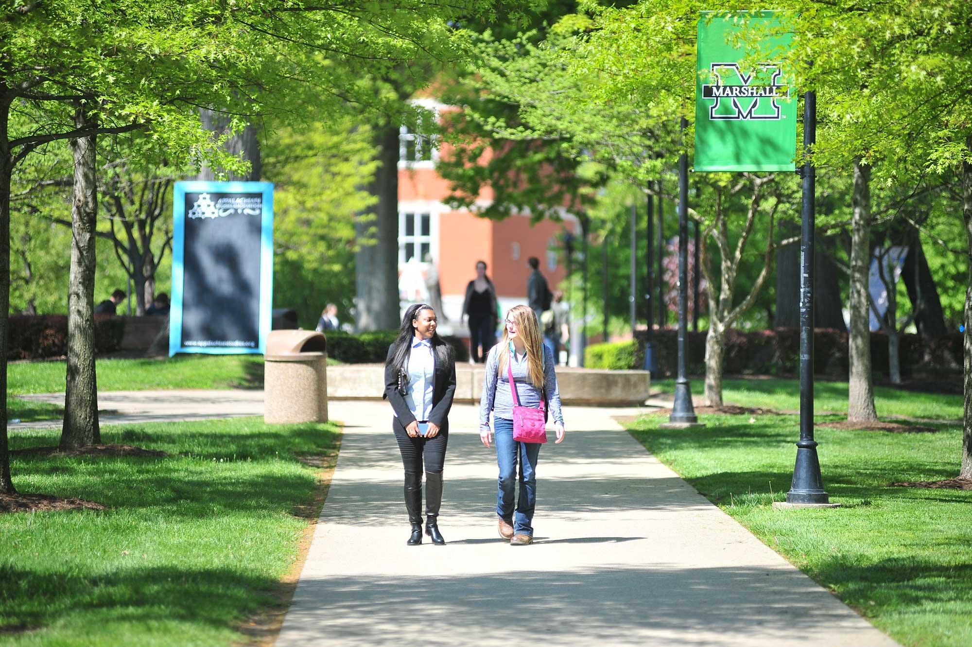 INTO Marshall students walking campus