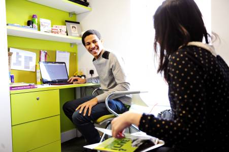 Students talking in a Shared Studio in the INTO Newcastle University student residences