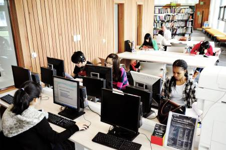 International students working at computer bank in Learning Resource Centre